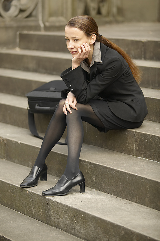 Disappointed woman on courthouse steps.jpg