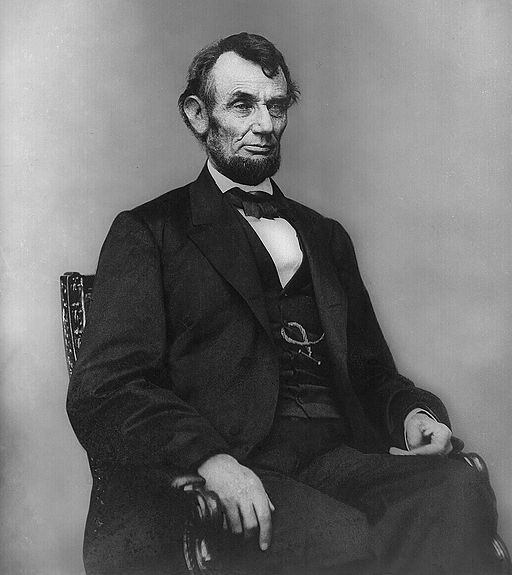 Abe Lincoln.Small.512px-Abraham_Lincoln_seated,_Feb_9,_1864.jpg